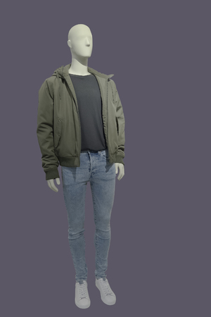Full-length male mannequin dressed in jacket with hood and blue jeans, isolated. No brand names or copyright objects. Standard-Bild