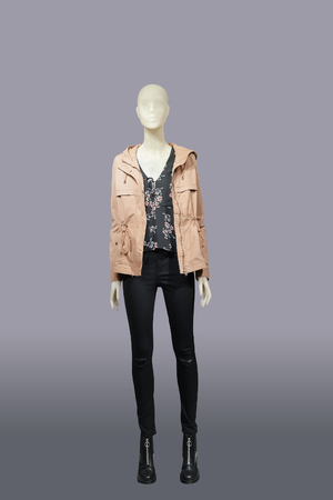 Full-length female mannequin wearing pink jacket and black jeans, isolated. No brand names or copyright objects. Imagens