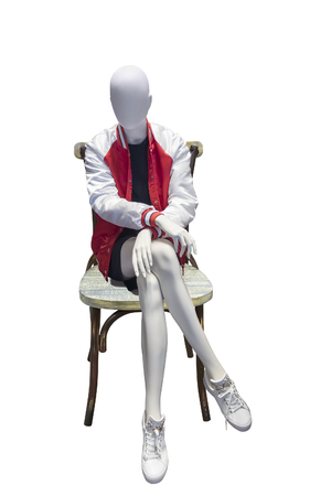 Female mannequin sitting on bentwood chair, isolated on white background. No brand names or copyright objects. Reklamní fotografie
