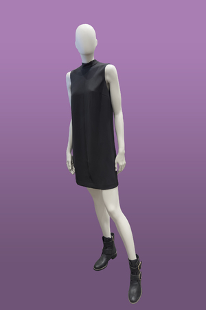 Full-length female mannequin wearing black dress, isolated. No brand names or copyright objects.