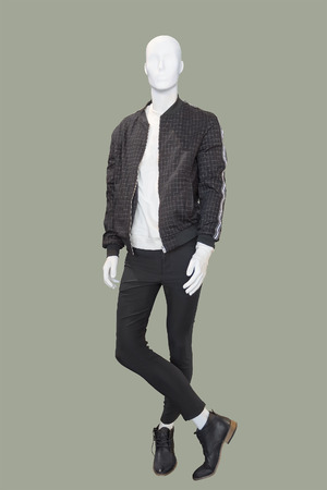 Full-length male mannequin dressed in casual clothes (jacket and trousers), isolated.  No brand names or copyright objects.