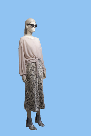 Full-length female mannequin dressed in casual clothes, isolated. No brand names or copyright objects.