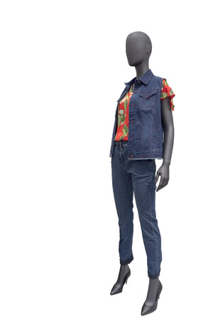 Full-length female mannequin dressed in jeans suit, isolated on white background. No brand names or copyright objects.