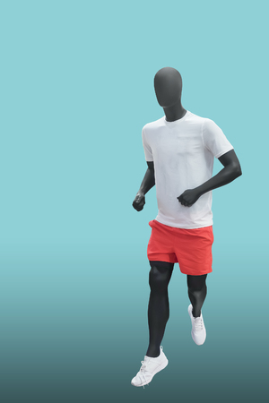 Running male mannequin, isolated. No brand names or copyright objects. Reklamní fotografie