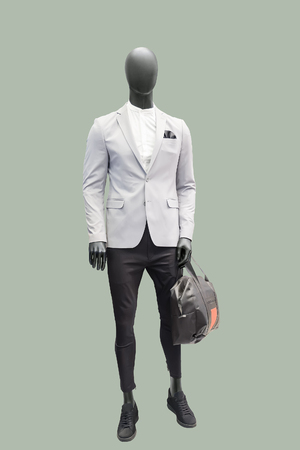 Full-length male mannequin dressed in fashionable clothes, isolated. No brand names or copyright objects.