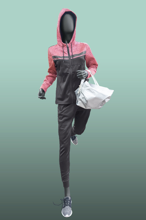Running female mannequin, isolated. No brand names or copyright objects. Reklamní fotografie