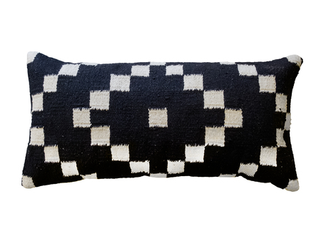 Decorative cushion with knitted geometric pattern. Isolated on white background.