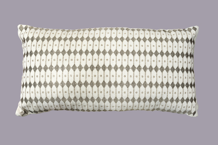 Decorative pillow with a pattern. Isolated on gray background. Reklamní fotografie