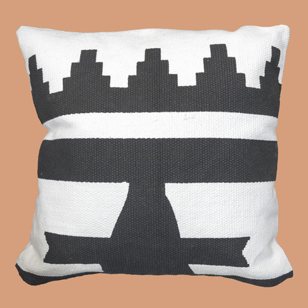 Decorative cushion with knitted geometric pattern, isolated. Reklamní fotografie