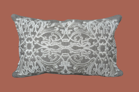 Decorative pillow with a pattern of silvery threads embroidered, isolated.