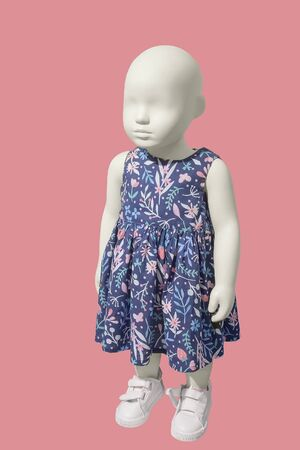 Full-length child mannequin wearing blue dress, isolated. No brand names or copyright objects. Imagens
