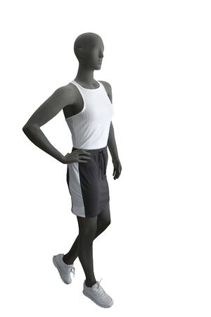 Full-length female mannequin wearing sport athletics clothes over white background. No brand names or copyright objects. Imagens