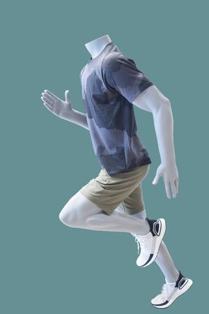 Running male mannequin, isolated on green background. No brand names or copyright objects.