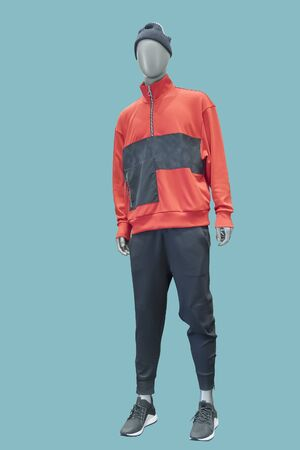 Full-length male mannequin dressed in sportswear, isolated. No brand names or copyright objects.