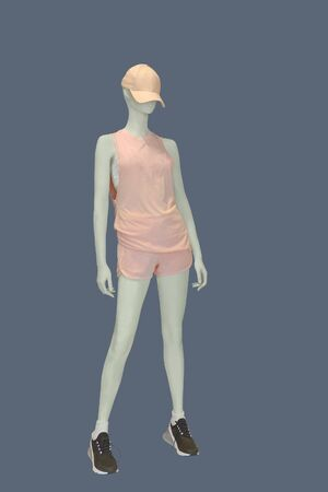 Full-length female mannequin dressed in summer fashionable clothes, isolated on gray background. No brand names or copyright objects. Stock fotó