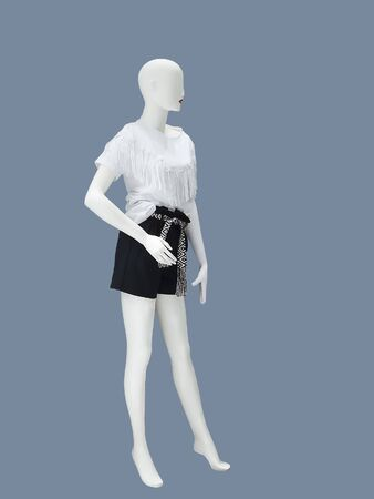 Full-length female mannequin dressed in summer fashionable clothes, isolated No brand names or copyright objects.