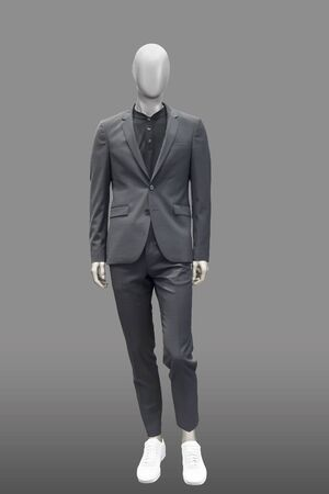 Full-length male mannequin dressed in fashionable suit, isolated. No brand names or copyright objects.