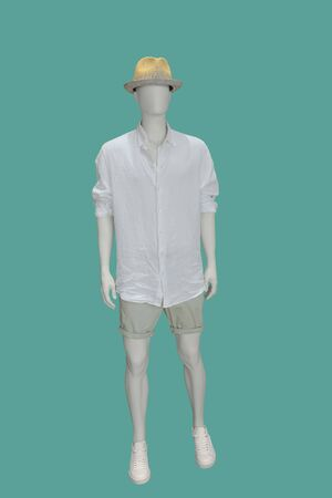 Full-length male mannequin dressed in summer casual clothes, isolated on green background. No brand names or copyright objects. Stock fotó