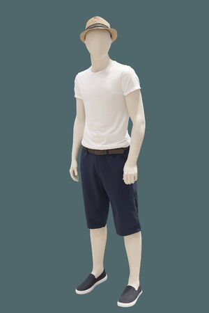 Full-length male mannequin dressed in short sleeve shirt and shorts, isolated on green background. No brand names or copyright objects. Reklamní fotografie