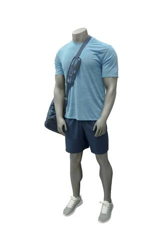 Male mannequin wearing sport athletics clothes over white background. Stock fotó