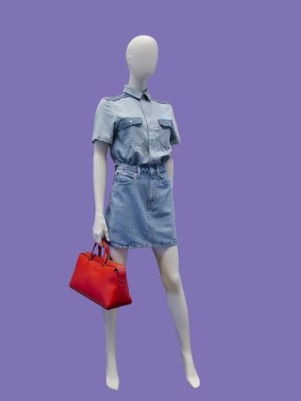 Full-length female mannequin dressed in jeans shirt and skirt, isolated. No brand names or copyright objects. Stock fotó