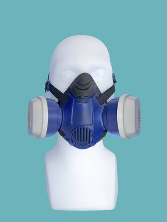 Mannequin wearing protective dust mask with valve over green background.