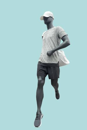 Running male mannequin isolated on blue background. No brand names or copyright objects.