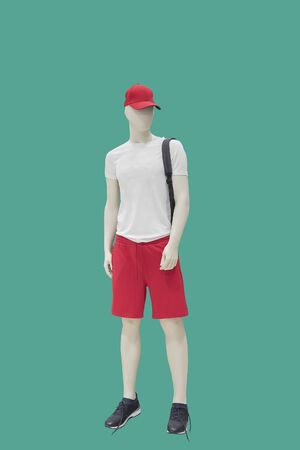 Full-length male mannequin in summer casual clothes, isolated on green background. No brand names or copyright objects.