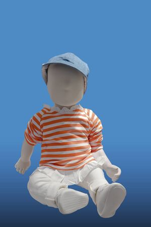 Toddler children mannequin dressed in casual clothes, isolated on blue background. No brand names or copyright objects.