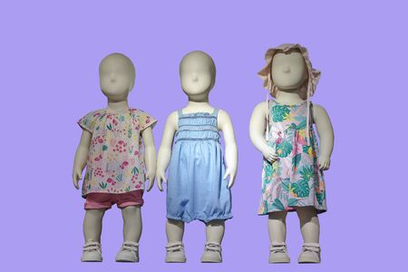 Three mannequins dressed in kids wear, isolated. No brand names or copyright objects.