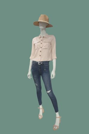 Full-length female mannequin dressed in blue jeans and pink blouse, isolated. No brand names or copyright objects. Reklamní fotografie