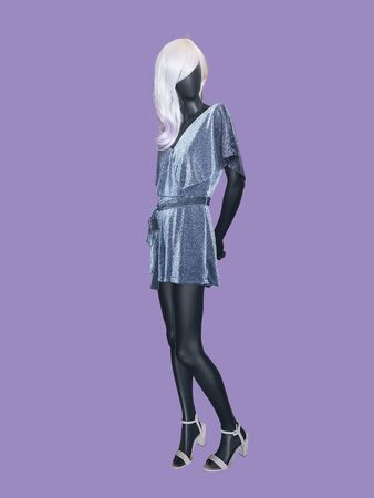 Full-length female mannequin wearing fashionable dress, isolated. No brand names or copyright objects.