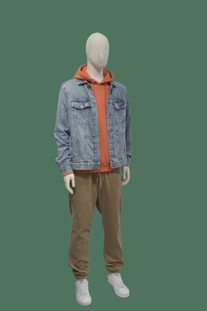 Full-length male mannequin dressed in warm casual clothes, isolated on green background. No brand names or copyright objects. 版權商用圖片