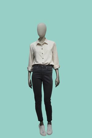 Full-length female mannequin dressed in summer casual clothes, isolated. No brand names or copyright objects.