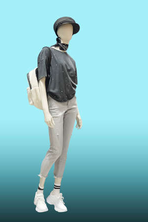 Full length female mannequin dressed in fashionable clothes, isolated. No brand names or copyright objects.