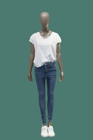 Full length female mannequin dressed in casual clothes, isolated on green background. No brand names or copyright objects.