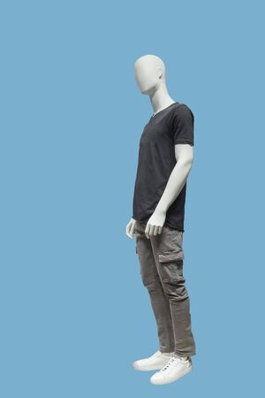Full length male mannequin dressed in casual clothes, isolated on blue background. No brand names or copyright objects.