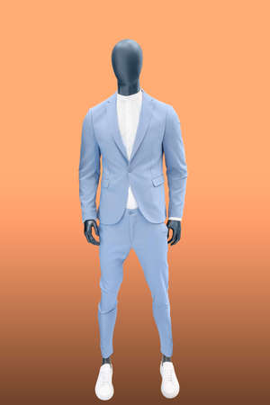 Full length male mannequin dressed in a blue suit, isolated. No brand names or copyright objects.