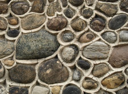 Natural stone masonry, wall made on rock stone, textured wall with background  Stock Photo