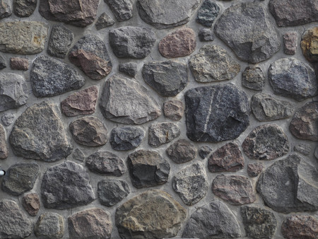 Natural stone masonry wall, made on rock stone, textured wall, background