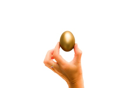 priceless: Womans hand holding a golden egg