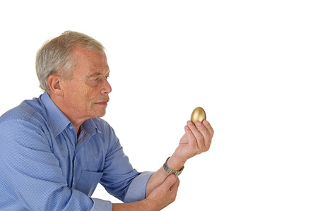 pleasent: Senior man with his golden egg. His fortunesavings. Pleasent age.