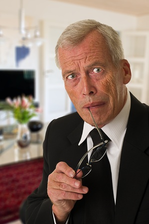 Businessman in black suit over a white background Stock Photo