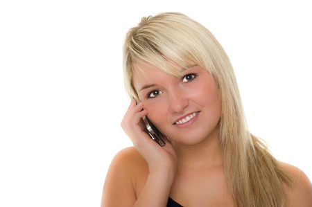 Young beautiful girl with smartphone smiling. Over white background Stock Photo