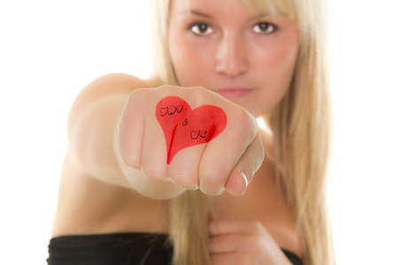 declare: Girl declare her love with a heart. Over white background Stock Photo