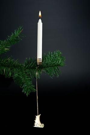 Christmas decoration. Candle light on a christmas tree.