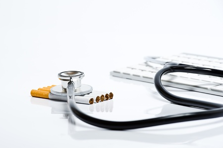 smoking: Examination of the dangers of smoking cigarettes on a white background