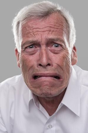 Oude aardige man bang witless. Bang voor pensioen Stockfoto