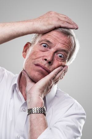 Elderly man puts his head in place photo