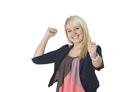 jubilation: Beautiful elated woman giving a victorious thumbs up and punching the air with her fist in jubilation